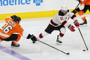Center Stephen Gionta (#11) of the New Jersey Devils skates around Center Zac Rinaldo (#36) of the Philadelphia Flyers