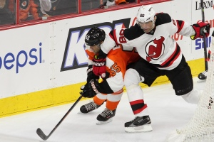 Right Winger Jaromir Jagr (#68) of the New Jersey Devils gets his right arm on Defenseman Nick Schultz (#55) of the Philadelphia Flyers