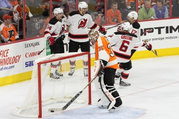 Right Winger Danius Zubrus (#8) of the New Jersey Devils celebrates his goal