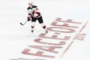 Defenseman Damon Severson (#28) of the New Jersey Devils skates over the Face-Off 2014 logo on the ice