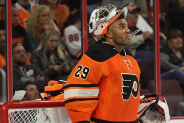 Goalie Ray Emery (#29) of the Philadelphia Flyers spits out some water