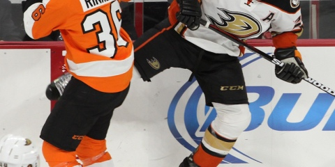 Center Zac Rinaldo (#36) of the Philadelphia Flyers and Defenseman Francois Beauchemin (#23) of the Anaheim Ducks collide into each other