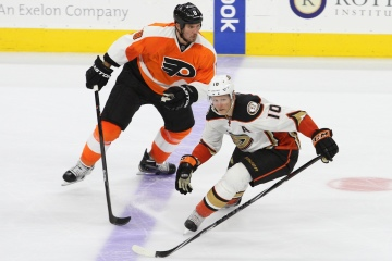 Defenseman Nicklas Grossmann (#8) of the Philadelphia Flyers and Right Wing Corey Perry (#10) of the Anaheim Ducks