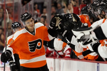 Center Brayden Schenn (#10) of the Philadelphia Flyers gets high-fives from the bench