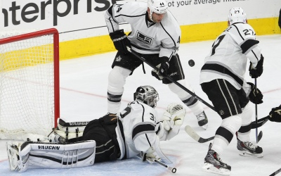 Goalie Jonathan Quick (#32), Left Wing Dwight King (#74) and Defenseman Alec Martinez (#27) of the Los Angeles Kings watch the airborne puck