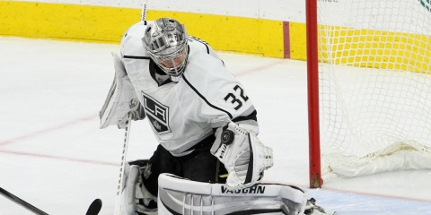Goalie Jonathan Quick (#32) of the Los Angeles Kings makes a save with his glove