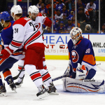 Carolina Hurricanes Brad Malone and Patrick Brown screen NY Islanders Goaltender Chad Johnson. (Brandon Titus/Inside Hockey)
