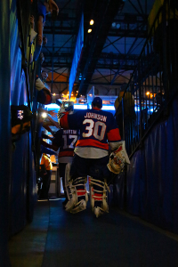 Chad Johnson high fives Islanders fans on his way out to the ice. (Brandon Titus/Inside Hockey)