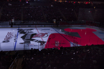 The New Jersey Devils debut their state of the art ice level video projection system in their home opener against the San Jose Sharks on October 18, 2014 at the Prudential Center in Newark, NJ.
