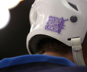 "A photo of Winnipeg Jets Adam Pardy's helmet sporting the ""Hockey Fights Cancer"" logo. (Brandon Titus/Inside Hockey)"