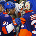 John Tavares congratulates Chad Johnson on the Islanders win over the Carolina Hurricanes
