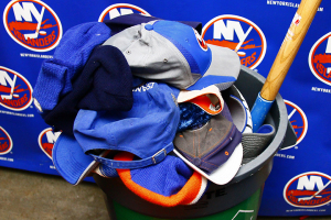 NY Islanders hats collected following John Tavares' Hat Trick during the game against the Dallas Stars(Brandon Titus/Inside Hockey)