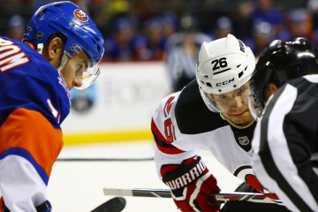 NY Islanders Johan Sundstrom and NJ Devils Patrik Elias wait for the puck drop.(Brandon Titus/Inside Hockey)