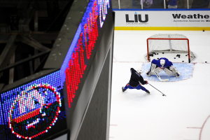 Taylor Cammarata dangles in front of Anthony Pupplo.(Brandon Titus/Inside Hockey)