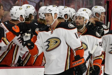 Right Wing Tim Jackman (#18) of the Anaheim Ducks gets congratulated by the bench after scoring