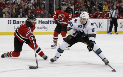 San Jose winger Matt Nieto takes the puck around New Jersey defensemen Andy Greene in a game on October 18, 2014 at the Prudential Center in Newark, NJ.