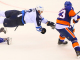 Winnipeg Jets Adam Pardy goes airborne after tripping over NY Islanders Corey Conacher. (Brandon Titus/Inside Hockey)