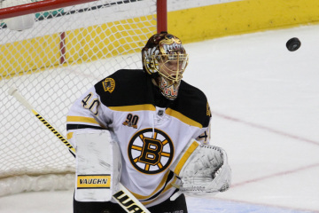 NHL 2014 - Mar 30 - BOS vs PHI - Goalie Tuukka Rask (#40) of the Boston Bruins eyes the airborne puck after rebounding off of himself