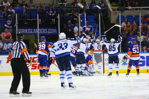 Winnipeg Jets Celebrate Paul Postma's Goal. (Brandon Titus/Inside Hockey)