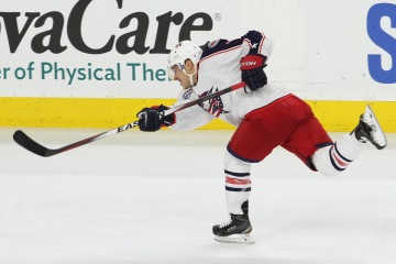 Right Wing Cam Atkinson (#13) of the Columbus Blue Jackets fires the puck