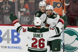 Left Wing Thomas Vanek (#26) and Center Charlie Coyle (#3) of the Minnesota Wild congratulate teammate Left Wing Jason Zucker (#16) after he scored a goal with 46 seconds left