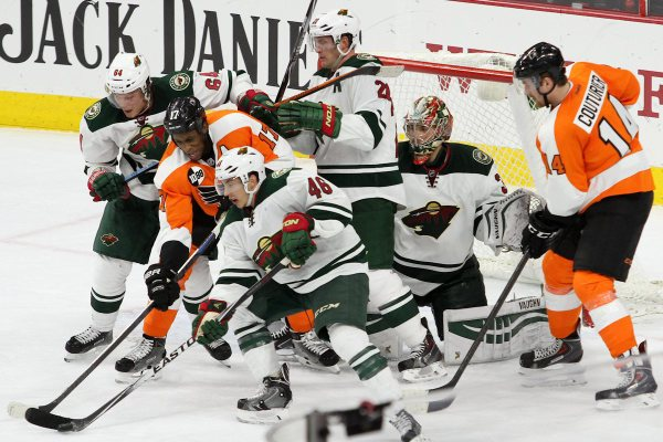 Defenseman Jared Spurgeon (#46) of the Minnesota Wild controls the puck