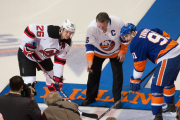 Saturday Night showdown at the Nassau Veteran Memorial Coliseum between the New Jersey Devils and the New York Islanders. Islander Legend Dennis Potvin drops  the first puck with New Jersey Devils left wing Patrik Elias #26 and New York Islanders center John Tavares #91. Final score Islanders 3 Devils 1