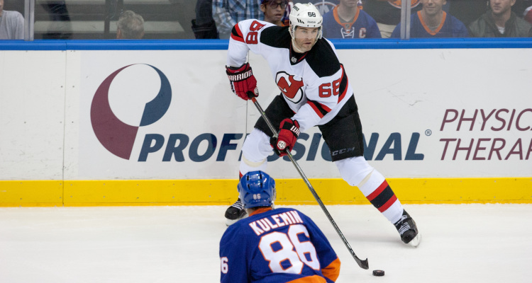 New Jersey Devils right wing Jaromir Jagr #68 looking for an open man to pass to Saturday Night at the Nassau Veteran Memorial Coliseum. Final score Islanders 3 Devils 1