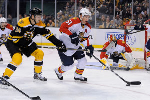 Florida Panthers defenseman Brian Campbell #51 and Boston Bruins center Carl Soderberg #34 battle for the puck