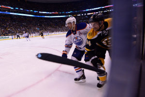 Boston Bruins defenseman Dennis Seidenberg (44) and Edmonton Oilers right wing Jordan Eberle (14)