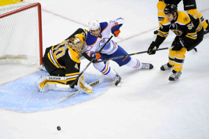 Edmonton Oilers center Boyd Gordon (27) in action against Boston Bruins goalie Tuukka Rask (40)