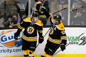 Boston Bruins center Patrice Bergeron (37) and Boston Bruins right wing Reilly Smith (18) celebrate