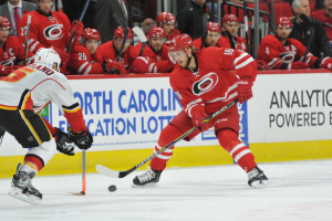 10 Nov 2014 Carolina Hurricanes Right Wing Elias Lindholm (16) [10261] skates with the puck during the third period of the game between the Calgary Flames and the Carolina Hurricanes at the PNC Arena in Raleigh, NC. Carolina defeated Calgary 4-1.