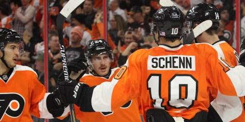 NHL 2014 - Nov 08 - COL vs PHI - Defenseman Michael Del Zotto (#15), Right Wing Matt Read (#24), and Center Brayden Schenn (#10) of the Philadelphia Flyers celebrate a goal