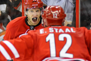 Eric Staal's (12) first assist to brother Jordan came on a game