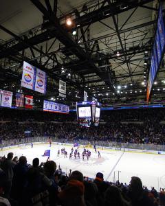 New York Islanders celebrate their seventh straight home win on the Nassau Veteran's Memorial Coliseum ice. (Brandon Titus/Inside Hockey)