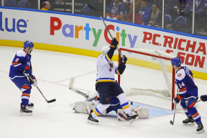 St Louis Blues David Backes celebrates as he  screens NY Islanders Jaroslav Halak. (Brandon Titus/Inside Hockey)