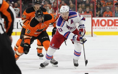 Center Derek Stepan (#21) of the New York Rangers pursued by Left Wing Pierre-Edouard Bellmare (#78) of the Philadelphia Flyers