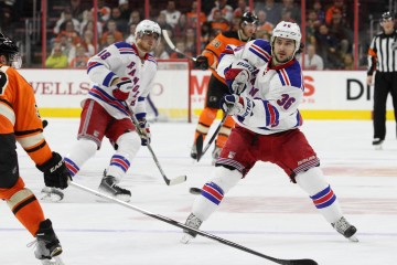 Right Wing Mats Zuccarello (#36) of the New York Rangers dumps the puck into the zone