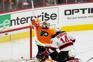 Center Adam Henrique (#14) of the New Jersey Devils watches the puck go over the head of Goalie Ray Emery (#29) of the Philadelphia Flyers