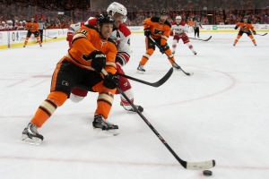 Left Wing R.J. Umberger (#18) of the Philadelphia Flyers gets a step on Defenseman Andrej Sekera (#4) of the Carolina Hurricanes