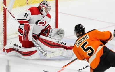 Goalie Anton Khudobin (#31) of the Carolina Hurricanes makes a save on a shot by Defenseman Braydon Coburn (#5) of the Philadelphia Flyers