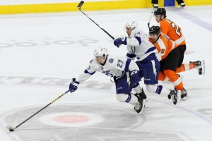 Left Wing Jonathan Drouin (#27) of the Tampa Bay Lightning skates with the puck while being followed by teammate Right Wing Ryan Callahan (#24) along with Defenseman Braydon Coburn (#5) and Center Claude Giroux (#28) of the Philadelphia Flyers