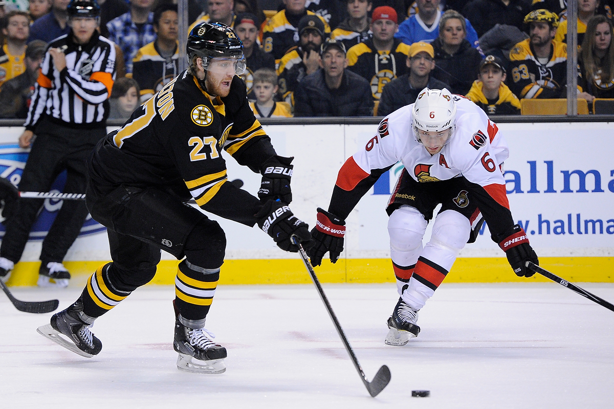 Dec 13, 2014; Boston Bruins defenseman Dougie Hamilton (27) clears the puck in front of Ottawa Senators right wing Bobby Ryan (6) during an NHL game in the TD Garden in Boston. (Photo: Brian Fluharty)