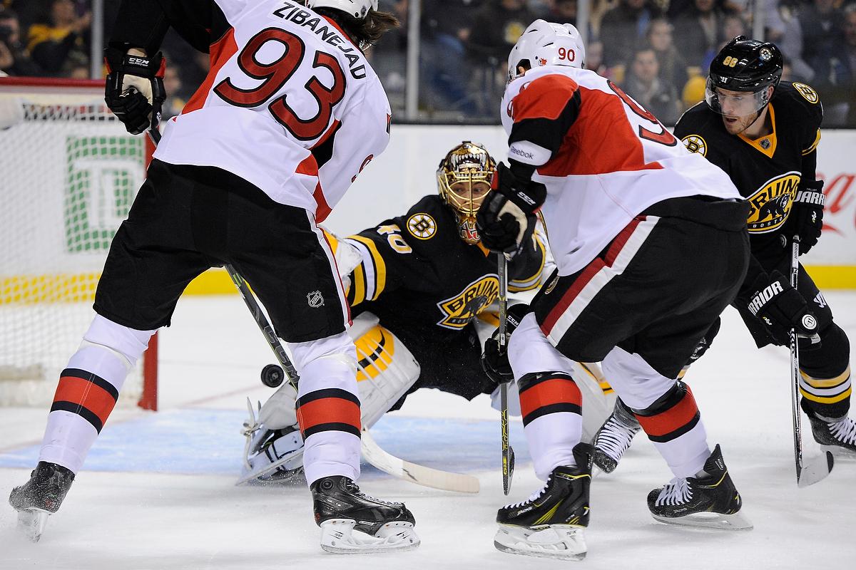 Dec 13, 2014; Boston Bruins goalie Tuukka Rask (40) blocks a shot during an NHL game in the TD Garden in Boston. (Photo: Brian Fluharty)