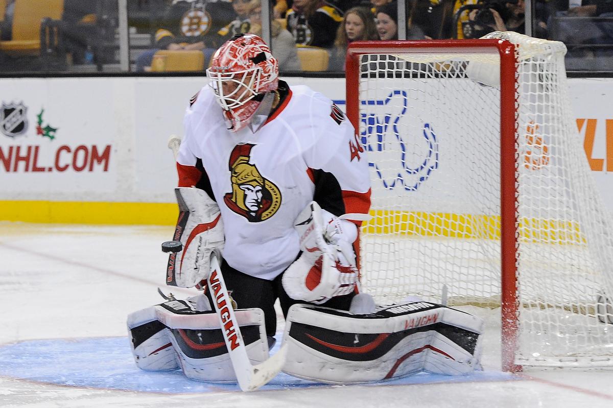 Dec 13, 2014; Ottawa Senators goalie Robin Lehner (40) blocks a shot during an NHL game in the TD Garden in Boston. (Photo: Brian Fluharty)