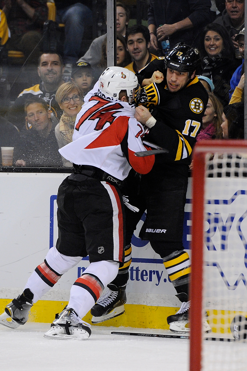 Dec 13, 2014; Boston Bruins left wing Milan Lucic (17) and Ottawa Senators defenseman Mark Borowiecki (74) fight during an NHL game in the TD Garden in Boston. (Photo: Brian Fluharty)