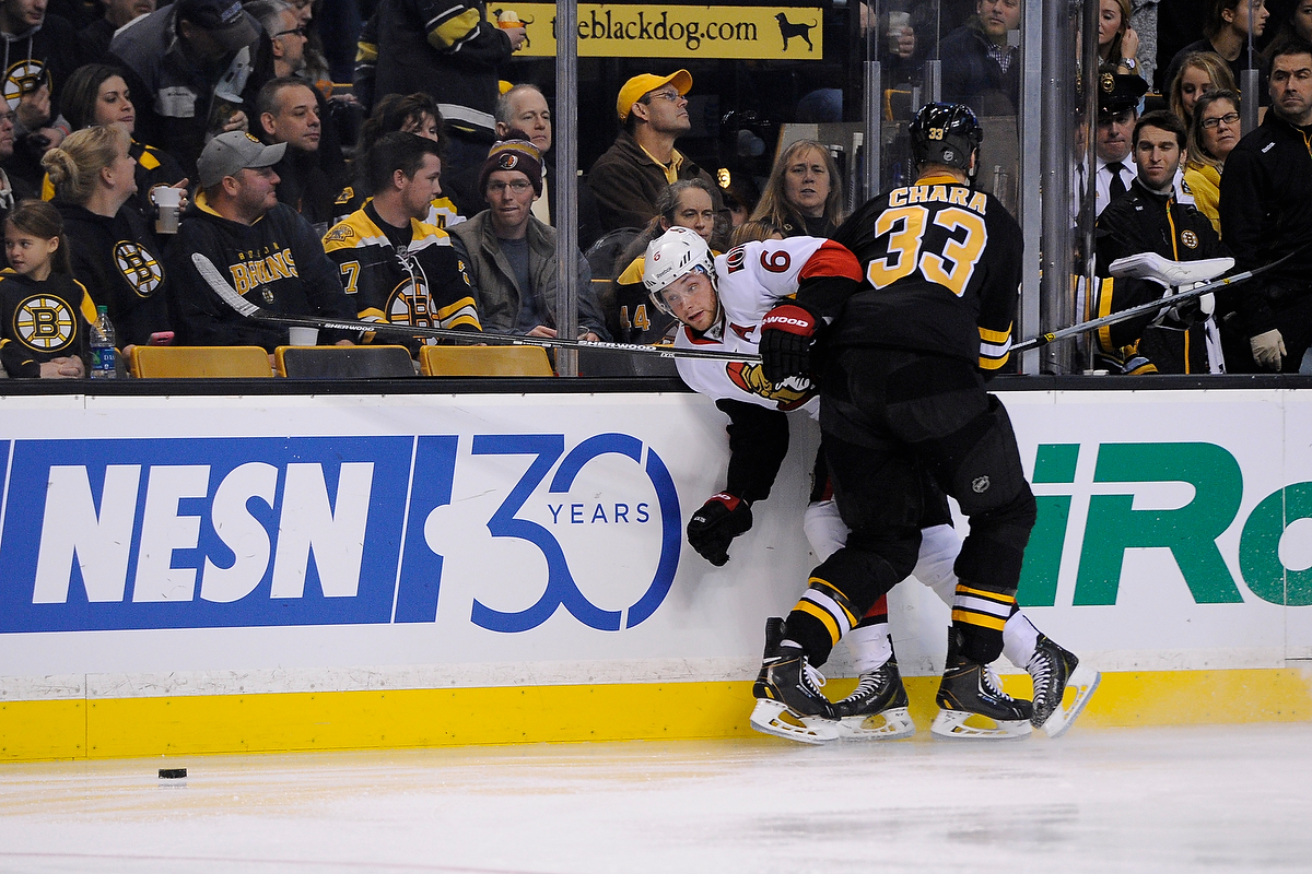 Dec 13, 2014; Boston Bruins defenseman Zdeno Chara (33) is called for interference on Ottawa Senators right wing Bobby Ryan (6) during an NHL game in the TD Garden in Boston. (Photo: Brian Fluharty)