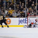 Dec 13, 2014; Boston Bruins left wing Brad Marchand (63) scores on Ottawa Senators goalie Robin Lehner (40) during the shootoutin a NHL game in the TD Garden in Boston. (Photo: Brian Fluharty)
