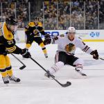 Chicago Blackhawks right wing Ben Smith (28) defends Boston Bruins defenseman Dougie Hamilton (27).